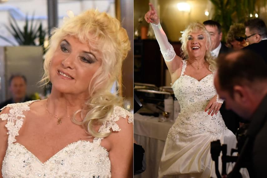 A 65 éves énekesnő egy elefántcsontszínű, gyöngyökkel díszített esküvői ruhát viselt.
