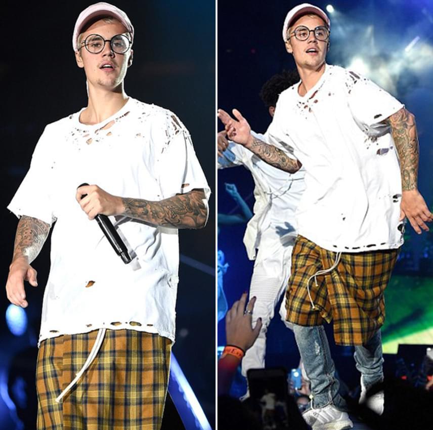 Justin Bieber elég érdekes szerelésben jelent meg hétfőn este New York-i koncertjén: baseballsapka, kerek szemüveg, lyukacsos póló, kockás szoknya, farmer és edzőcipő.