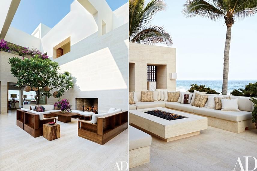 Spanyolországból hozatták a hófehér köveket a terasz kialakításához - a teljes luxus érzéséhez persze hozzátartozik két kültéri kandalló is.