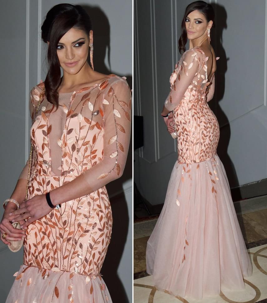 Kulcsár Edina  A volt szépségkirálynő és műsorvezető a Bernice Fashion egy barackos árnyalatú, sellő fazonú darabban gyűjtötte a bókokat.