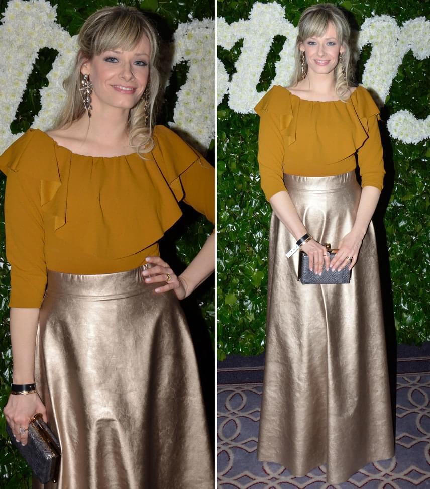 Peller MariannA műsorvezető az Envy okker-arany összeállításában tündökölt a 18. Story-gálán.