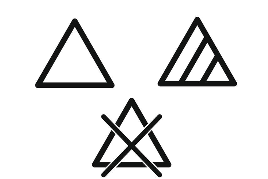Az egyenlő oldalú háromszög a fehérítést jelenti, legyen szó a mosás közbeni vagy utáni fehérítésről. Ha üres a háromszög, bármilyen fehérítést lehet alkalmazni, ha át van húzva, tilos a fehérítés, ha pedig ferde vonalak vannak benne, csak klórt nem tartalmazó szerrel lehet végezni.