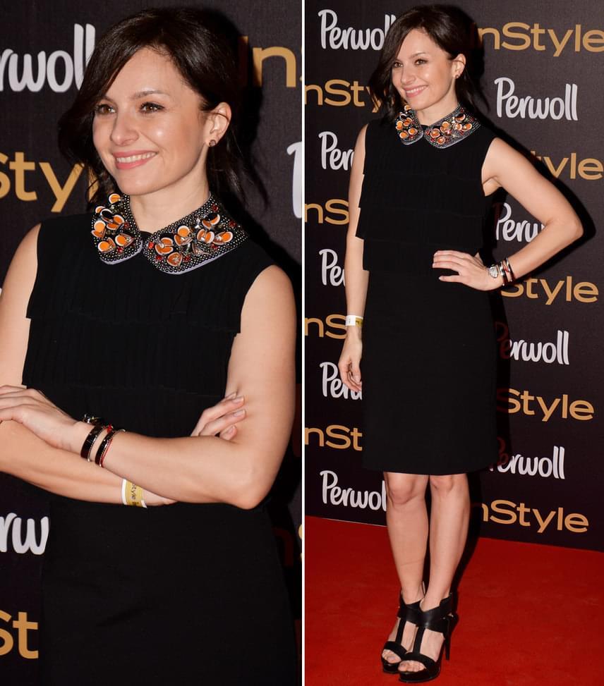 Zséda  Az énekesnő a black&gold dress code-nak ebben a franciásan sikkes, fekete, arany gallérral díszített ruhában tett eleget.