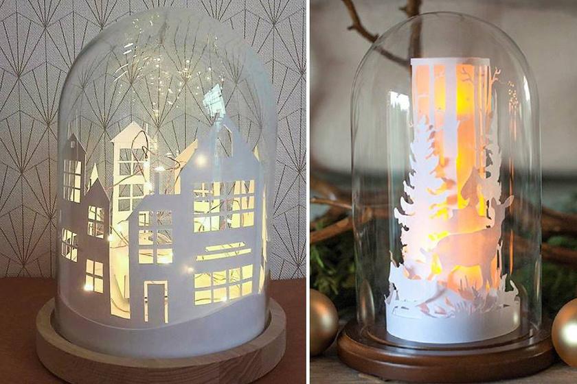 Vastag papírból kivágott kontúrokkal lehet megidézni a házak világító ablakait vagy egy erdőt a fákkal és az állatokkal. Kis teljesítményű égősort tegyél a karton mögé, nehogy felgyulladjon!