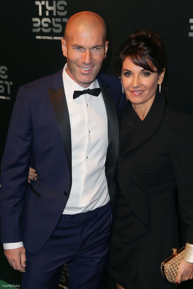 Zinedine és Véronique Zidane annyira feketében vannak, hogy szinte teljesen beleolvadnak a háttérbe.