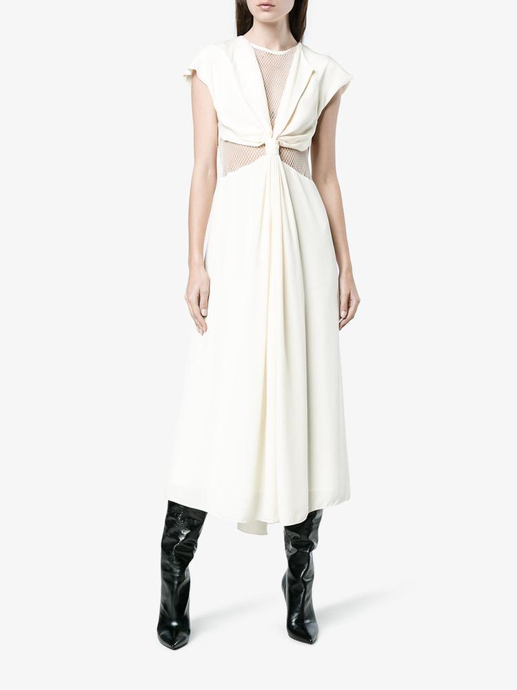 Oldalt kivágott fehér ruha a Kitx-től 610 fontért, kb.212 ezer forintért.