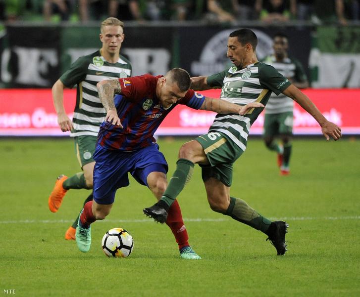 Az angyalföldi Ádám Martin és a ferencvárosi Leandro de Almeida az OTP Bank Liga 30. fordulójában játszott Ferencváros-Vasas FC mérkõzésen Groupama Arénában-