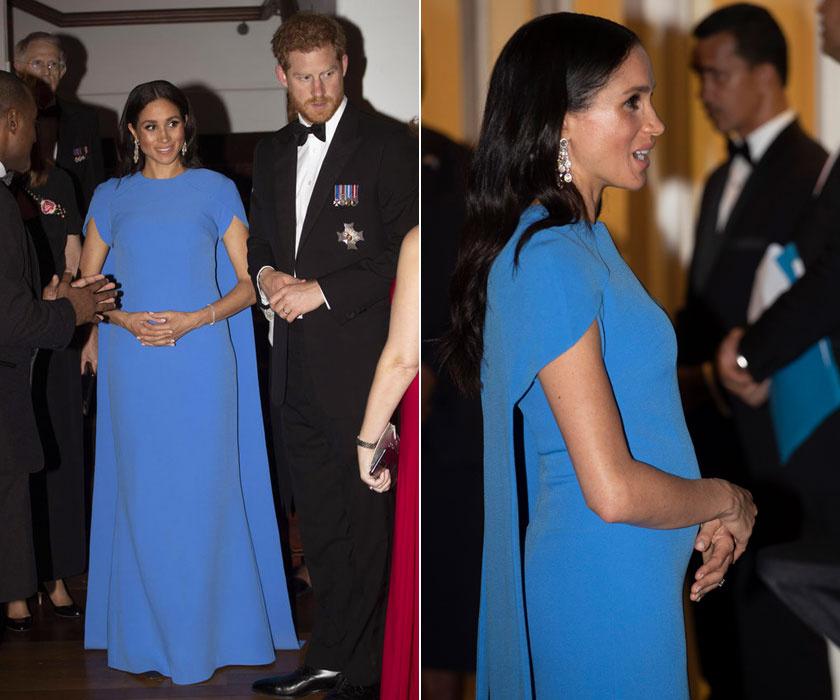 Meghan láthatóan kedveli a Safiyaa márkát. Ez a földig érő, kék ruha remek választás volt a házaspár Fidzsi-szigeteki utazásán megrendezett vacsorán. Ráadásul a kerekedő pocakját is szépen mutatja.