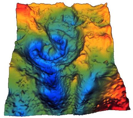 A Chicxulub-kráter jól azonosítható a Mexikói-öböl fenekének háromdimenziós, a gravitációs anomáliákat jelző térképén.(Sharpton, Lunar and Planetary Institute)