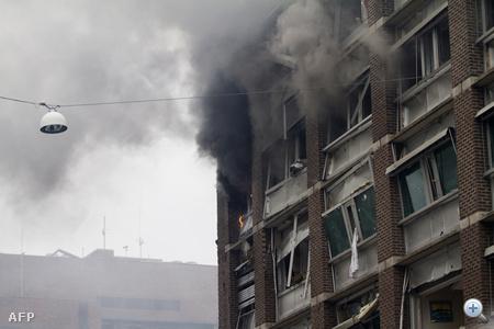 Füst száll fel a felrobbantott oszlói kormányzati épületből a 2011 júliusi merénylet után