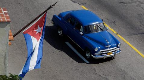cuban-classic-car-with-flag