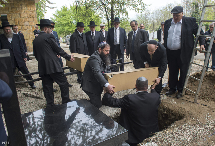 The reburial of the remains found under Margaret Bridge at the Kozma Street Jewish Cemetery on 15 April 2016.