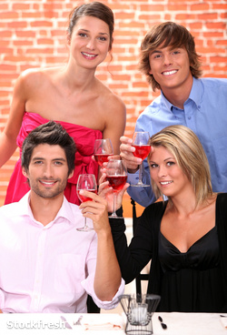 stockfresh 1296396 two-young-couples-drinking-wine-in-restaurant