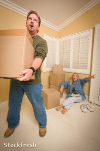 stockfresh 674746 stressed-man-moving-boxes-for-demanding-wife s