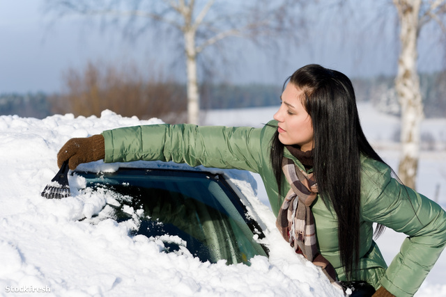 stockfresh 677964 winter-car---woman-remove-snow-from-windshield