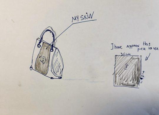 Joan tervei a saját bőréből készült táskáról.