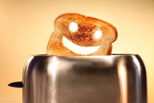 stockfresh 214564 toast-with-smiley-face-in-toaster-on-counter s