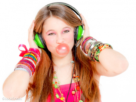 stockfresh 847598 funky-girl-listening-to-music-and-blowing-bubb