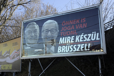 In other parts of Budapest, the posters featuring George Soros behind Jean-Claude Juncker are still untouched,