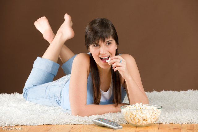 stockfresh 836102 woman-teenager-watch-television-eat-popcorn si