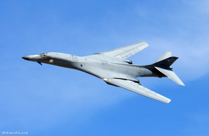 A B-1 Lancer performs a fly-by during a firepower demonstration
