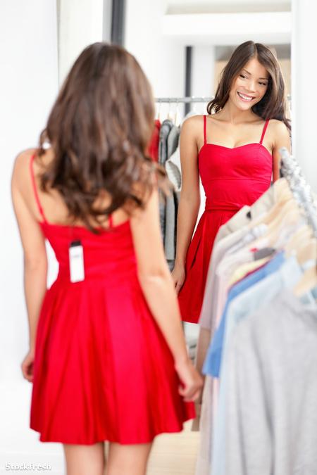 stockfresh 1632363 woman-trying-dress sizeM