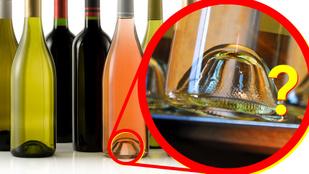 Miért van az a bemélyedés a borosüvegek alján?