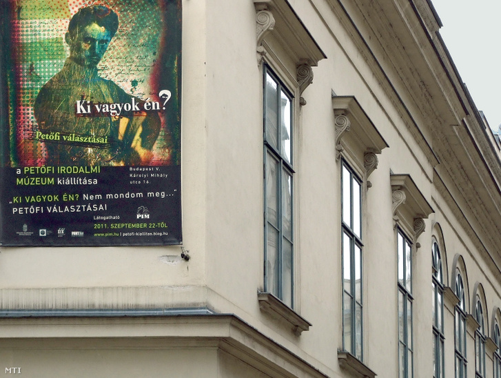 """""""Who am I?"""" the poster featuring the portrait of Sándor Petőfi asks on the side of the Petőfi Literary Museum."""