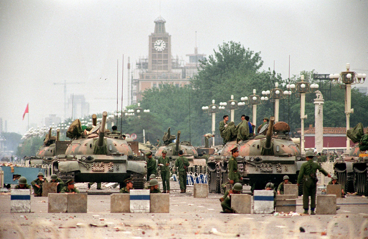 This file photo taken on June 6 1989 shows People's Liberation Army (PLA) tanks and soldiers guarding the strategic Chang'an Avenue leading to Tiananmen Square in Beijing two days after their crackdown on pro-democracy students. Hundreds possibly thousands of protesters were killed by China's military on June 3 and 4 1989 as communist leaders ordered an end to six weeks of unprecedented democracy protests in the heart of the Chinese capital.