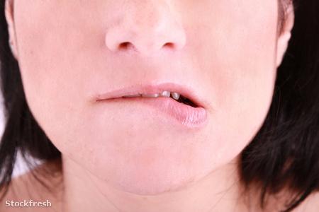 stockfresh 1157660 an-embarrassed-woman-biting-on-her-lip sizeM