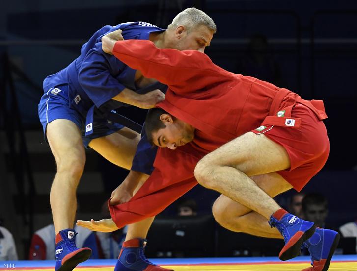 Sirankó Ferenc (pirosban) és a lett Viktors Resko a férfi szambo 100 kilogrammos súlycsoportjának negyeddöntőjében a II. Európa Játékokon a minszki Sportpalotában 2019. június 22-én.