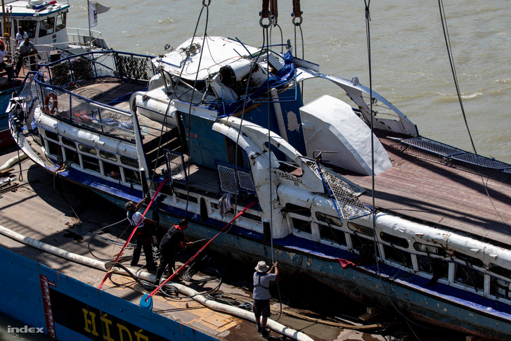 The wreckage of the Hableány being secured onto the barge after the rescue team lifted it from the Danube on 11 June 2019.