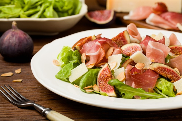 Fresh salad with figs and prosciutto with parmesan cheese and to