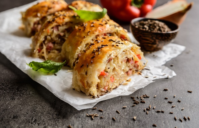 Savory strudel stuffed with sour cabbage, bacon, red pepper and