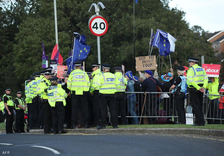 Police surround protesters against Brexit and against the government's policies with regards to Brexit as Britain's Prime Minister Boris Johnson gives a speech during a visit with the police in West Yorkshire northern England on 5 September 2019.