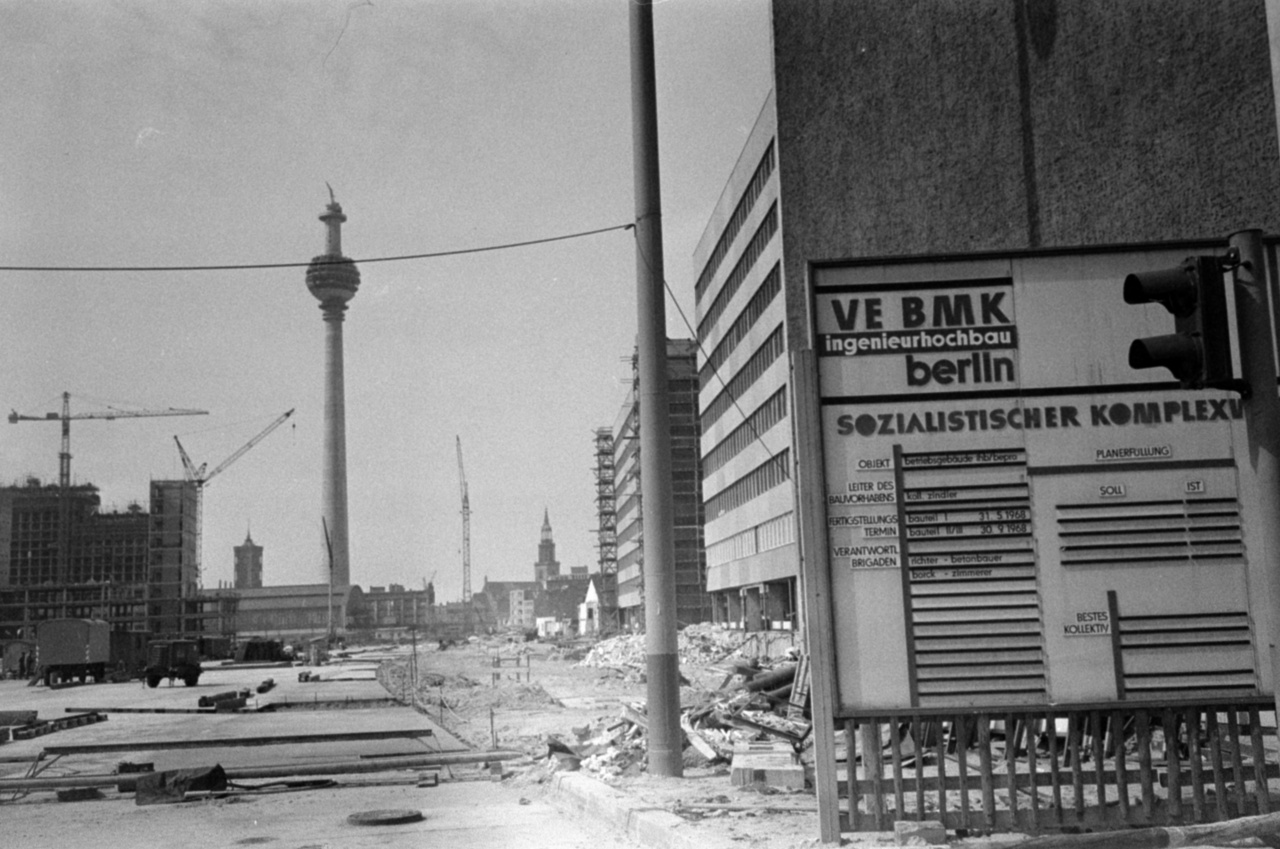 The state tried to soften the crushing housing shortage with tenement programs. Entire districts grew out of the ground using this technology, for instance, Halle-Neustadt that is still around today and has a 100 000 residents. In total, around 2 million apartments were built in East Germany using this technology. Pictured here: The centre of East Berlin with the famous TV tower.