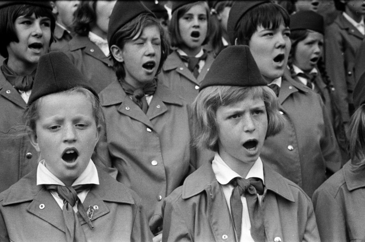 Following the example of the Soviet Union, the Pioneer Movement of East Germany was founded in 1948. The Young Pioneers (Junge Pionere) wore blue ties and hats, and they graduated to be Thälmann-Pioniers in the fourth grade, which granted them red ties.