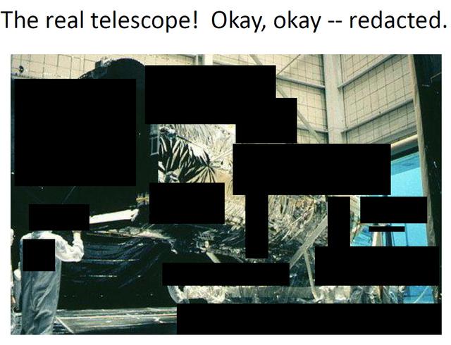 Alan Dressler csillagász tréfásan ezt a képet mutatta be a csillagászok és asztrofizikusok tanácsának konferenciáján, mint az egyik ajándékba kapott szupertitkos műholdat. A hallgatóság jót mulatott a csupa fekete kitakarással dekorált képen, ami eredetileg a még szerelés alatt álló Hubble űrteleszkópot ábrázolja.