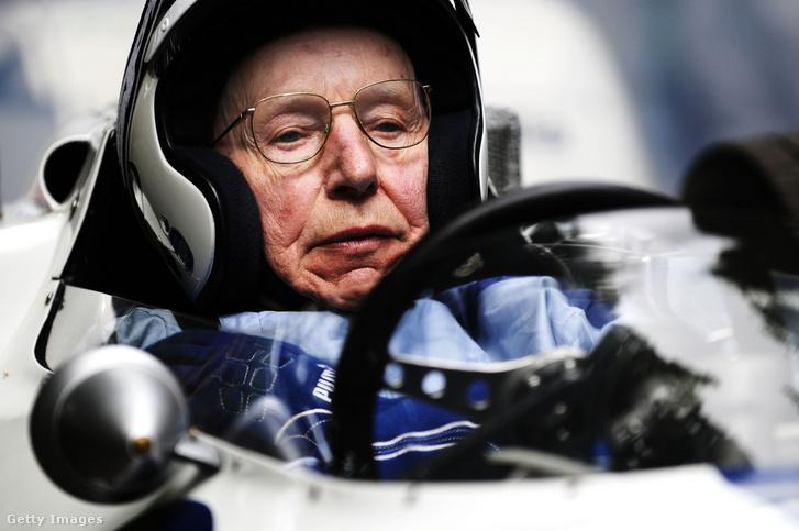 John Surtees 2014-ben, 80 évesen a Ferrari 158 volánjánál a Goodwood Festival of Speeden.