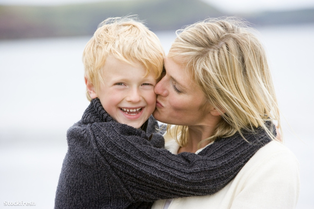 stockfresh 94959 mother-kissing-son-at-beach-smiling sizeS