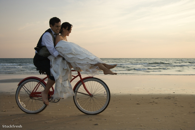stockfresh 8810 couple-riding-bike-on-beach sizeS