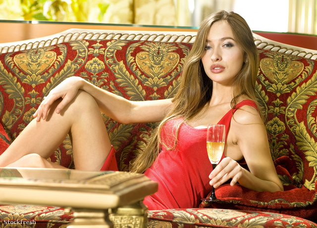 stockfresh 339227 beautiful-woman-on-a-sofa-with-glass-of-wine s