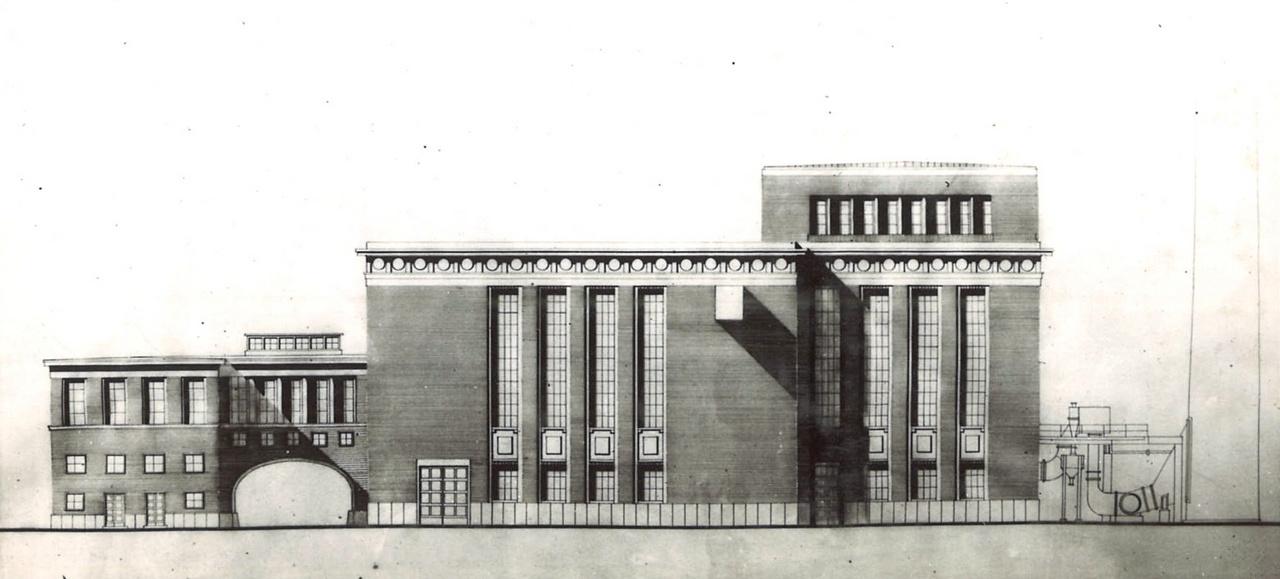 Miközben a közintézmények és a nagy lakótelepekkötelezően szocreál stílusban épültek az ötvenes évek elején, az ipari építészetben ritkán jelent meg ez az irányzat. Nem volt sem hatékony, sem olcsó. Leginkább ott használták, ahol valami miatt reprezentálásra volt szükség.  Ez például a Csepeli Papírgyár erőművének terve, Wappler József, Mayer Pál Albert, Kemper Ervin munkája (1953-1958).