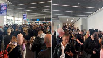 Tömött sorokban vártak a beléptetésre a Ferihegyre érkező utasok