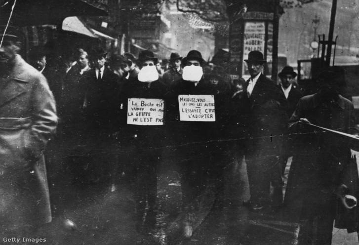 A spanyolnátha elleni védekezésül maszkviselésre buzdítő férfiak Párizsban 1919 márciusában.