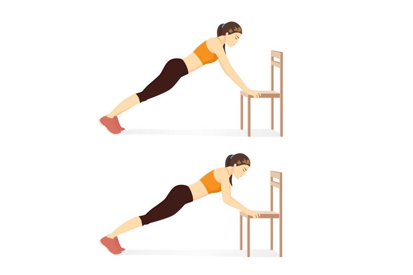 Nyújtott kézzel támaszkodj meg a szék ülőfelületén, a lábfejedet pedig spiccben támaszd meg a talajon. Húzd ki magad, könyökhajlítással engedd le a mellkasod a képen látható módon, majd nyomd vissza magad a kiinduló pozícióba. Végezd egy percig a gyakorlatot.