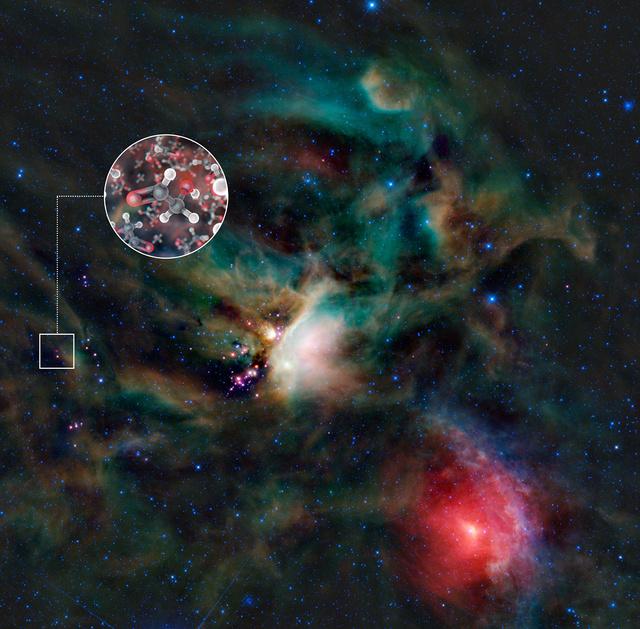 A ρ Ophiuchi csillagkeletkezési terület a NASA WISE (Wide-field Infrared Explorer) műholdjának felvételén. Az IRAS 16293-2422 a vörös objektum a kis fehér négyzet közepén. A körben a detektált cukormolekula modelljei láthatók. A WISE-felvételen a kék és a cián a 3,4 és 4,6 mikronos infravörös sugárzást kódolják, ami főleg a csillagoktól származik. A zöld és vörös színek által kódolt 12 és 22 mikronos sugárzás forrása főként a por.