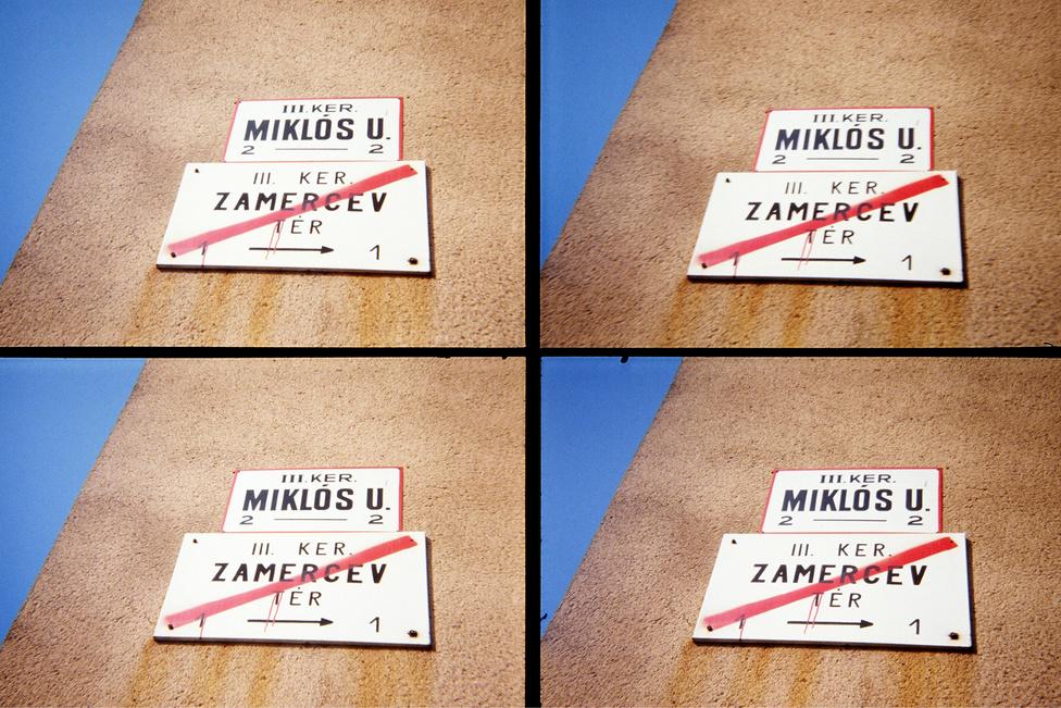 Budapest, 1990.                         Az óbudai Miklós utca a II. Világháború után                         mindvégig megőrizte a nevét. A 80-as évek közepe felé azonban a legelejét, hirtelen Zamercev tábornokról nevezték el.                         Néhány évvel később visszakapta az eredeti nevét. A                         felvétel egy négyoptikás fényképzőgéppel készült.