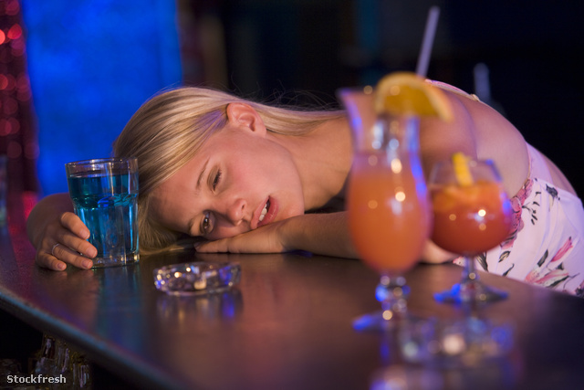 stockfresh 90769 drunk-young-woman-resting-head-on-bar-counter s