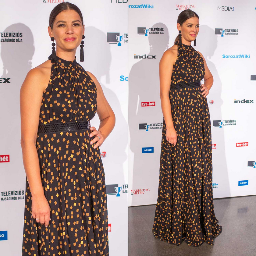 Ördög Nóra egy fekete, arany mintával díszített, földig érő, Robert Maar-kreációban vette át a legjobb női műsorvezetőnek járó díjat.